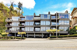 Apartment building with walkway with brenches. Royalty Free Stock Photo