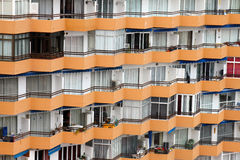 Apartment building windows with balconies Stock Photo