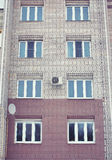 Apartment building with windows Stock Images