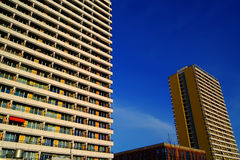 Apartment Buildings. Abstract of high-rise apartment buildings in East Berlin.  Taken from low perspective.  Deep blue sky background Stock Photo