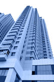 Apartment buildings. Modern apartment buildings toned in blue color over white background Stock Photos