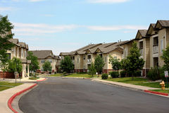 Apartment Buildings. View of lane of apartment buildings in summertime stock image