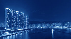 Apartment buildings cityscape at night. (Duotone) Stock Photography