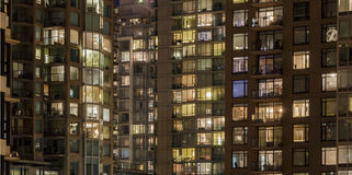 Apartment buildings with lights on Stock Photography