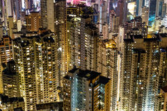 Apartment buildings at night in Hong Kong Stock Images