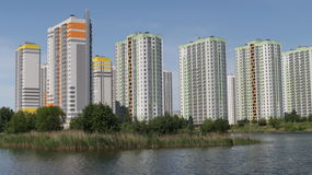 Apartment buildings over the water Royalty Free Stock Photo