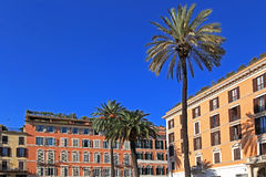 Apartment buildings with palm trees. Apartment buildings of a typical Mediterranean style with colored stucco exteriors Stock Photos