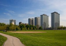 Apartment buildings & park. Tall parallel apartment buildings and park with baseball field Royalty Free Stock Images