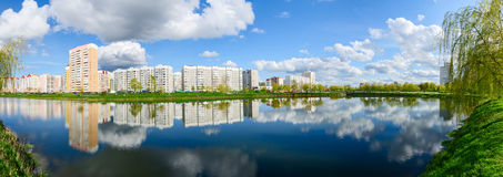Apartment buildings in recreation area with cascade of lakes, Go. Apartment buildings in a modern recreation area with a cascade of lakes in Volotova district Stock Images