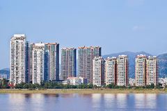 Apartment buildings with river view near a mountain ridge, Wenzhou, Zhejiang Province, China Royalty Free Stock Photo
