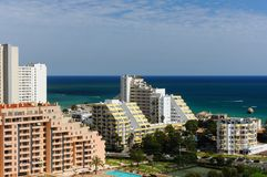 Apartment buildings with the sea on the background in Portimao, Algarve & x28;Portugal& x29; stock photo