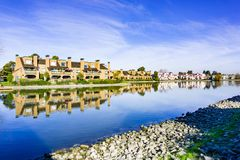 Apartment buildings on the shoreline of Belmont Channel, Redwood shores, California stock photo