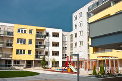 Apartment complex. A modern apartment complex with a playground stock photography