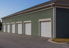 Apartment Complex Garage Units. Individual apartment garage units for renters and leasers of apartment housing royalty free stock photos