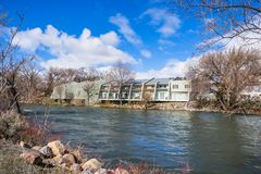 Apartment complex on the shoreline of Truckee River, Reno, Nevada; increased water level due to snow melt royalty free stock photos