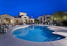 Apartment/Condo Swimming Pool at Dusk Royalty Free Stock Photography