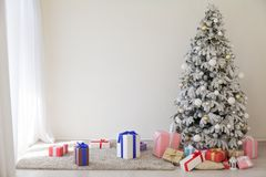 Apartment decor for the new year Christmas tree and gifts. Apartment decor for the new year with a Christmas tree and gifts Stock Photo