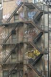 Apartment firescapes. New york apartment fire escapes with graffitti Stock Photos