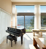 Apartment furnished,  lounge with piano Stock Photo