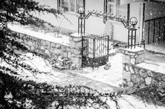 Apartment Gate In The Snow. Gate of a typical apartment in a Turkish neighborhood under the snow with fierce wind stock photos
