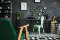 Apartment with home office area. And cozy armchair royalty free stock photos