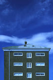 Apartment house. Single house against a magnificent blue sky stock photos