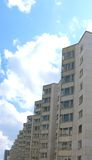 Apartment house. The multi-storey apartment house photographed in a clear sunny day on a background of the blue sky Stock Photo