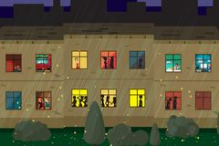 Apartment house in the autumn rainy evening. People in the house Stock Photo