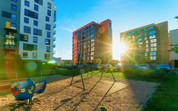 Apartment house building complex concept playground sun light. Apartment house building complex concept. Street with children playground. With sun light royalty free stock photography