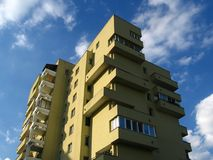 Apartment house in clouds. Apartment house, cloudly sky, Warszawa, Poland royalty free stock images