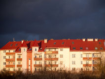 Apartment house with dark clouds over Royalty Free Stock Image