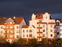 Apartment house with dark clouds over Royalty Free Stock Images
