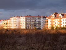 Apartment house with dark clouds over Royalty Free Stock Photo