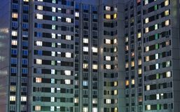 Apartment house evening. Russian modern contemporary architecture: illuminated widows in residental building / apartment house / dwelling house domestic building Royalty Free Stock Photo