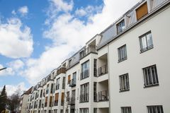 Apartment house in Germany, nice residential area. Multi-family stock photography
