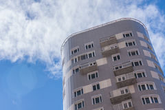 Apartment house in a horizontal frame. Apartment house against a blue, cloudy sky Stock Images