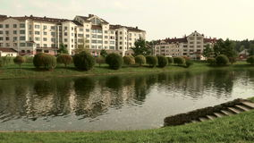 Apartment house on the lake. Autumn daytime. Smooth dolly shot.  stock footage
