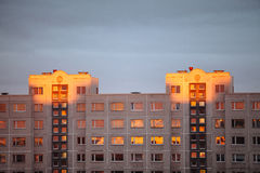 Apartment house in the rays of sunset Stock Photos