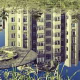 Apartment house is reflected in a pond Stock Photography