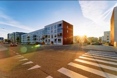 Apartment house residential building complex street parking sunset street. Apartment house residential building complex real estate concept. And road with street royalty free stock photo