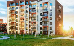 Apartment house residential building outdoor sun light concept. Apartment house residential building outdoor concept. Street and backgrounds. Sun light stock images