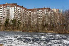 Apartment house on river bank. The panel apartment house on river bank in Saint-Petersburg suburb, Russia Royalty Free Stock Photography