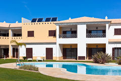 Apartment house with swimming pool Stock Images