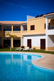 Apartment house with swimming pool Stock Image