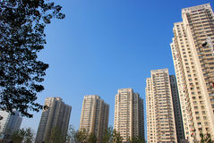 Apartment houses of city in sky. Apartment houses of city in blue sky,cityscape Stock Images