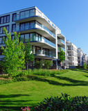 Apartment houses and green grass Royalty Free Stock Image