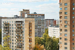 Apartment houses in urban quarter in autumn day Stock Photos