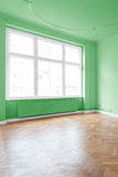 Apartment interior, green walls. Room with green walls and parquet floor Royalty Free Stock Photography