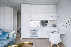 Apartment interior with white kitchenette