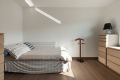 Apartment interior, simple bedroom Royalty Free Stock Photography